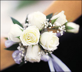 White Mini Roses Wristlet from Swindler and Sons Florists in Wilmington, OH